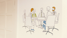 Wandbild von Arbeitsgruppe im Seminarraum
